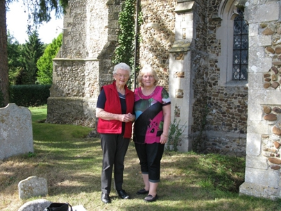 Dot Harvey (left), with her daughter Bev Pollard in the churchyard of St Michael and All Angels