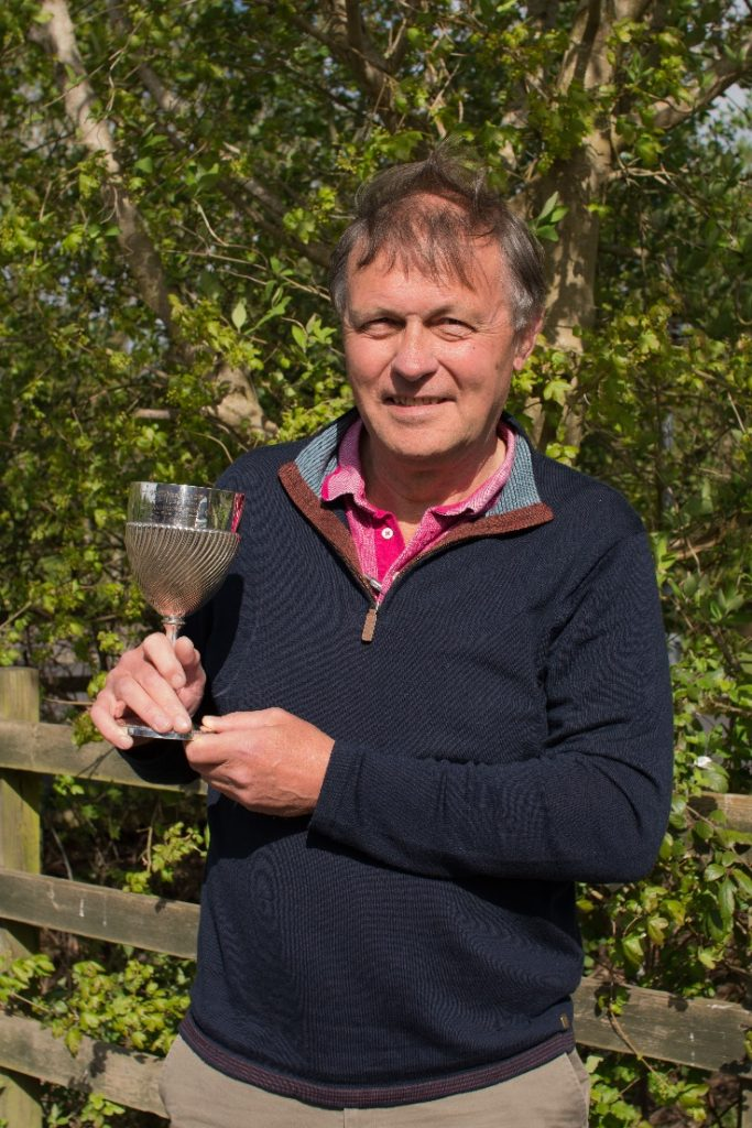 David Green holding his great grandfather's inscribed trophy from the 1897 Gransden Show © A Day for CLHG